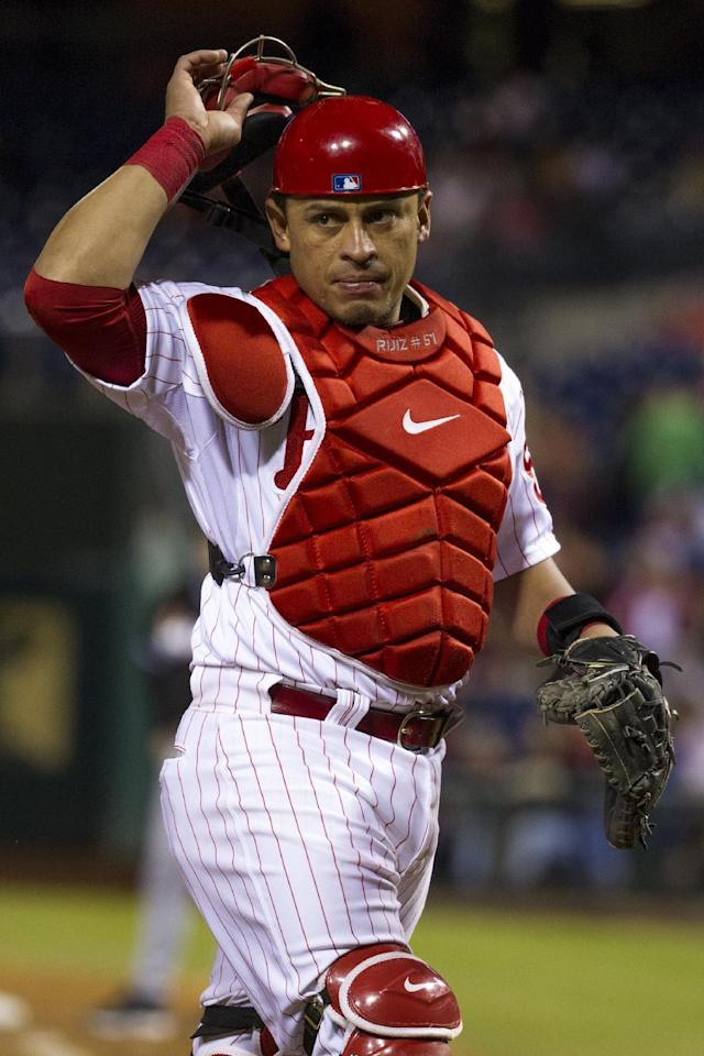 Philadelphia Phillies catcher Carlos Ruiz looks toward the Marlins dugout during the eighth inning of a baseball game, Tuesday, Sept. 17, 2013, in Philadelphia. The Phillies win 6-4. (AP Photo/Chris Szagola)