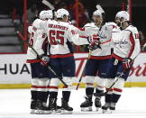 Washington Capitals players celebrate the goal of defenseman Michal Kempny (6) against the Ottawa Senators during the second period of an NHL hockey game, Saturday, Dec. 22, 2018, in Ottawa, Ontario. (Justin Tang/The Canadian Press via AP)