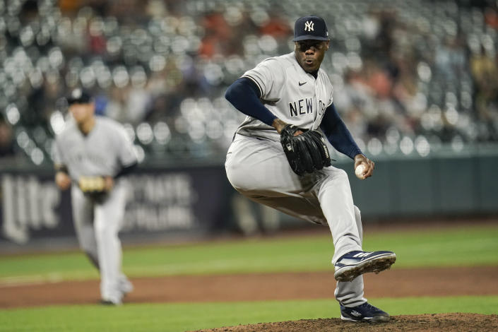New York Yankees relief pitcher Aroldis Chapman throws a pitch to the Baltimore Orioles during the ninth inning of a baseball game, Tuesday, Sept. 14, 2021, in Baltimore. (AP Photo/Julio Cortez)