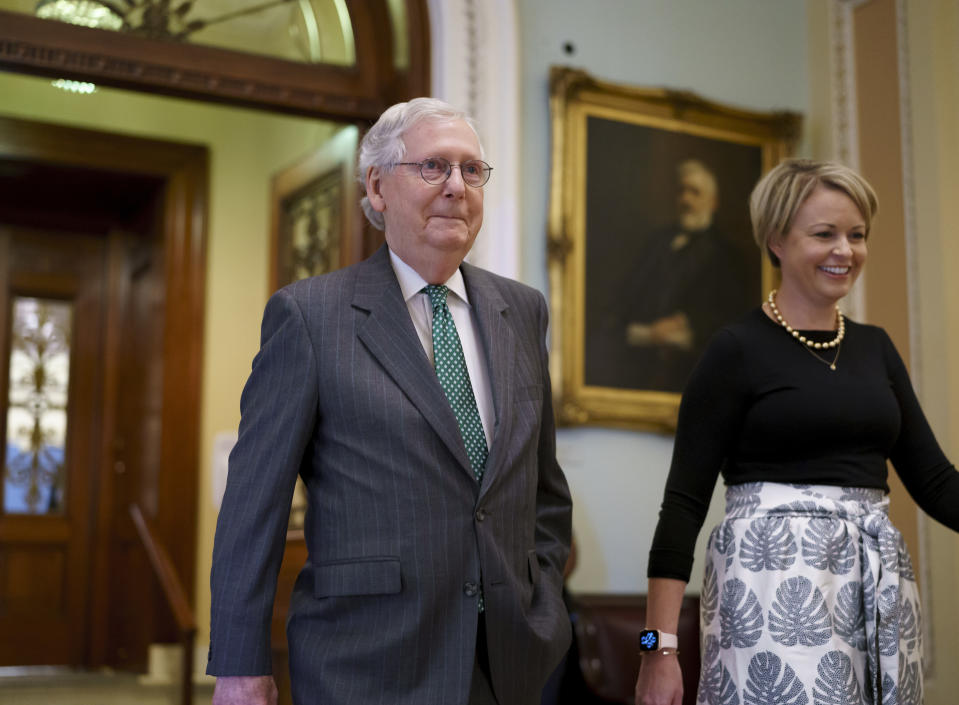Senate Minority Leader Mitch McConnell, R-Ky., leaves the chamber, joined by top aide Stefanie Muchow, right, as lawmakers work to advance the $1 trillion bipartisan bill, at the Capitol in Washington, Thursday, Aug. 5, 2021. (AP Photo/J. Scott Applewhite)