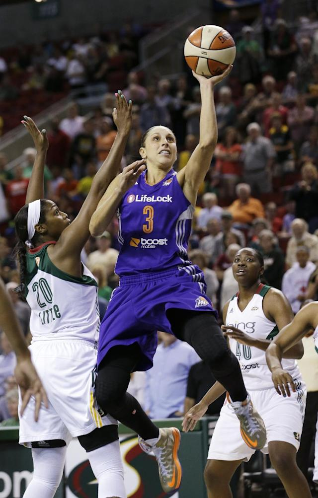 Phoenix Mercury's Diana Taurasi (3) drives the lane between Seattle Storm's Camille Little, left, and Shekinna Stricklen in the first half of a WNBA basketball game on Thursday, Aug. 1, 2013, in Seattle. (AP Photo/Elaine Thompson)