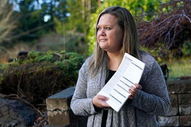 PHOTO: Rep. Tarra Simmons poses with blank voter registration forms at her home in Bremerton, Wash., Dec. 9, 2020. (Ted S. Warren/AP, FILE)