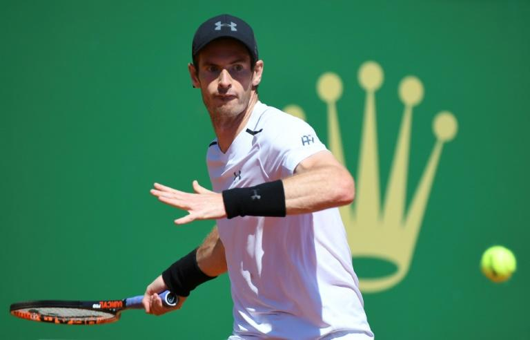 Britain's Andy Murray hits a return to Spain's Albert Ramos-Vinolas during their Monte-Carlo ATP Masters Series tennis tournament on April 20, 2017 in Monaco