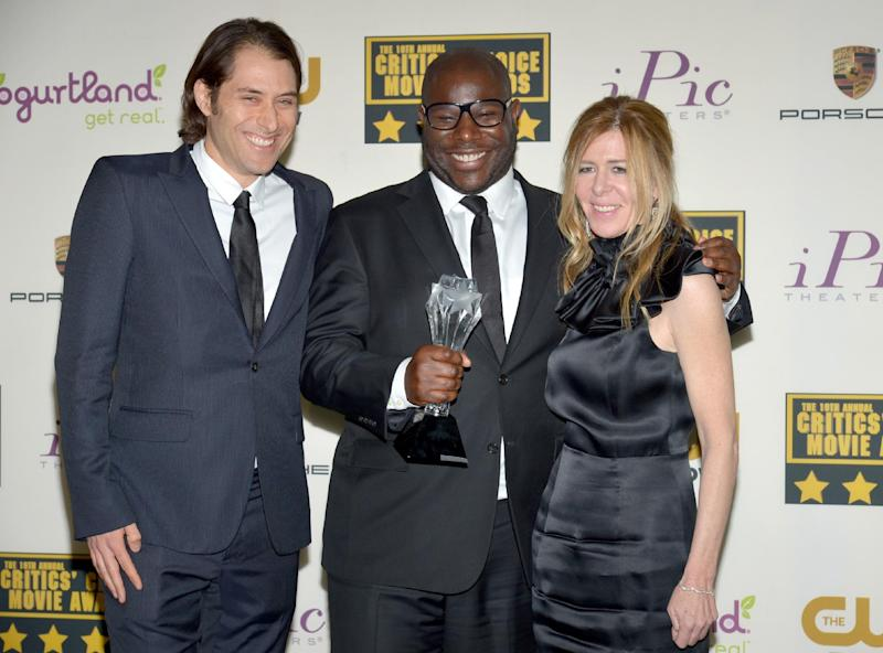 """From left, Jeremy Kleiner, Steve McQueen and Dede Gardner pose in the press room with the award for best picture for """"12 Years a Slave"""" poses in the press room at the 19th annual Critics' Choice Movie Awards at the Barker Hangar on Thursday, Jan. 16, 2014, in Santa Monica, Calif. (Photo by John Shearer/Invision/AP)"""