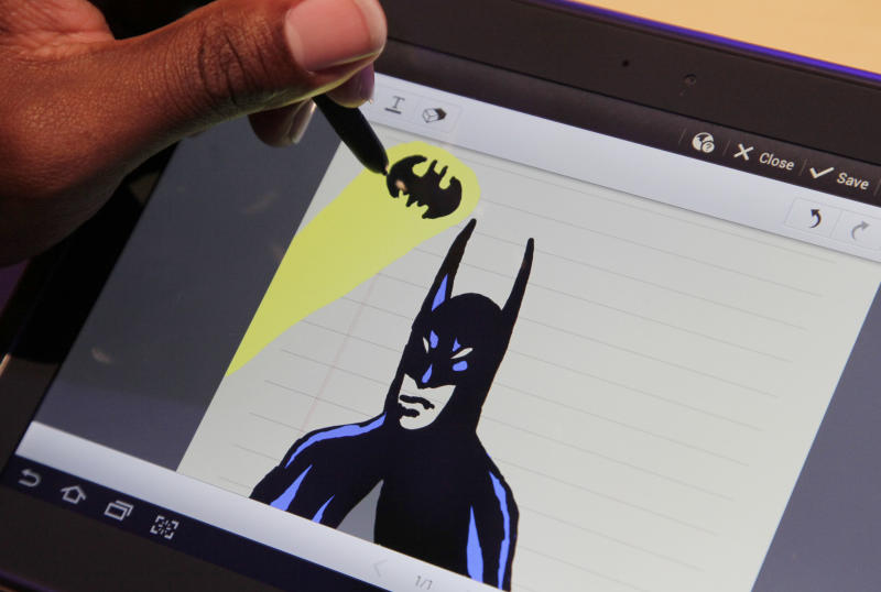An artist uses the Samsung Galaxy Note to draw a Batman figure at a news conference, Wednesday, Aug. 15, 2012 in New York. Available in the U.S. starting Thursday, the $499 tablet comes with a pen, or more precisely, a stylus. The Galaxy Note shows that the pressure is building on the iPad, and Apple will have to work if it wants to maintain its lead. (AP Photo/Mark Lennihan)