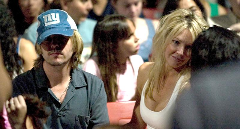 David Spade and Heather Locklear attend a Go-Go's concert on July 14, 2006, in L.A. (Photo: J. Strauss/FilmMagic)