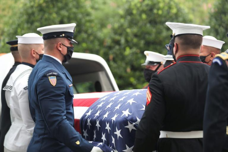 A military honor guard carries the casket of John Lewis