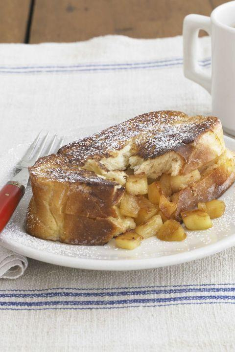 "<p>A chunky filling of apples sautéed in butter, sugar, and nutmeg gives French toast an all-American upgrade. </p><p><strong><a href=""https://www.countryliving.com/food-drinks/recipes/a3452/apple-french-toast-recipe-clv0910/"" rel=""nofollow noopener"" target=""_blank"" data-ylk=""slk:Get the recipe"" class=""link rapid-noclick-resp"">Get the recipe</a>.</strong></p>"