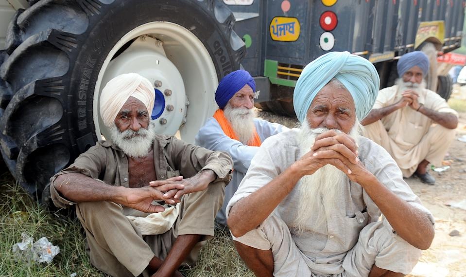 Farmers during the protest against the Electricity Amendment Bill 2020 and agriculture reforms bills passed in the Parliament, at NH-7 Delhi-Amritsar Highway, at Shambhu Border, on September 25, 2020 in Patiala, India. The two bills - the Farmers (Empowerment and Protection) Agreement on Price Assurance and Farm Services Bill, 2020 and the Farming Produce Trade and Commerce (Promotion and Facilitation) Bill, 2020 - were passed by the Rajya Sabha despite uproar and strong protest by the Opposition parties in the house. (Photo by Bharat Bhushan/Hindustan Times via Getty Images)