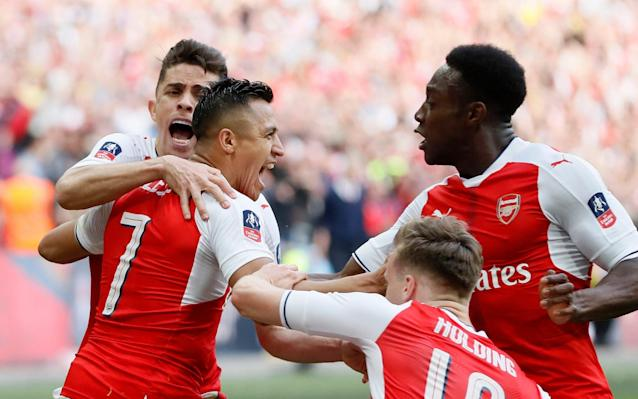 Arsenal's player celebrate Alexis Sanchez's extra-time winner  - AP