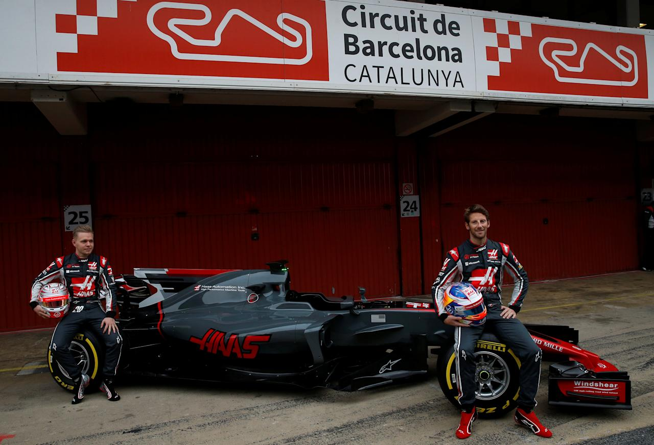 Spain Formula One - F1 - 2017 Haas VF-17 Formula One Car Launch - Barcelona-Catalunya racetrack in Montmelo - 27/2/17. Haas's drivers Romain Grosjean and Kevin Magnussen pose with the new VF-17 racing car. REUTERS/Albert Gea
