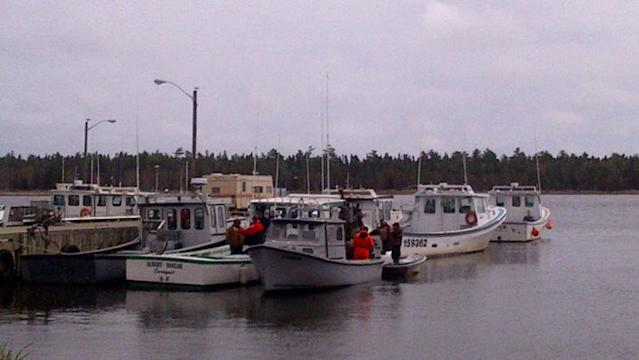 One person is dead and 2 are missing after a lobster boat went aground and capsized off the coast of New Brunswick