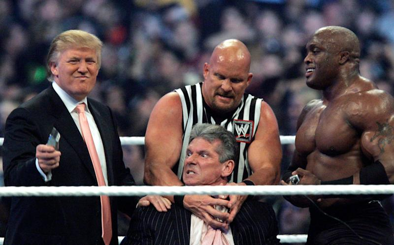"FILE - In this Sunday, April 1, 2007, file photo, WWE Chairman Vince McMahon, center, held by ""Stone Cold"" Steve Austin, prepares to have his hair cut off by Donald Trump, left, and Bobby Lashley, right, after Lashley defeated Umaga at Wrestlemania 23 at Ford Field in Detroit. Wrestling aficionados say President Trump, who has a long history with the game, has borrowed tactics of the sport to cultivate the ultimate antihero character - who wins at all costs, incites outrage and follows nobody's rules but his own. (AP Photo/Carlos Osorio, File)"
