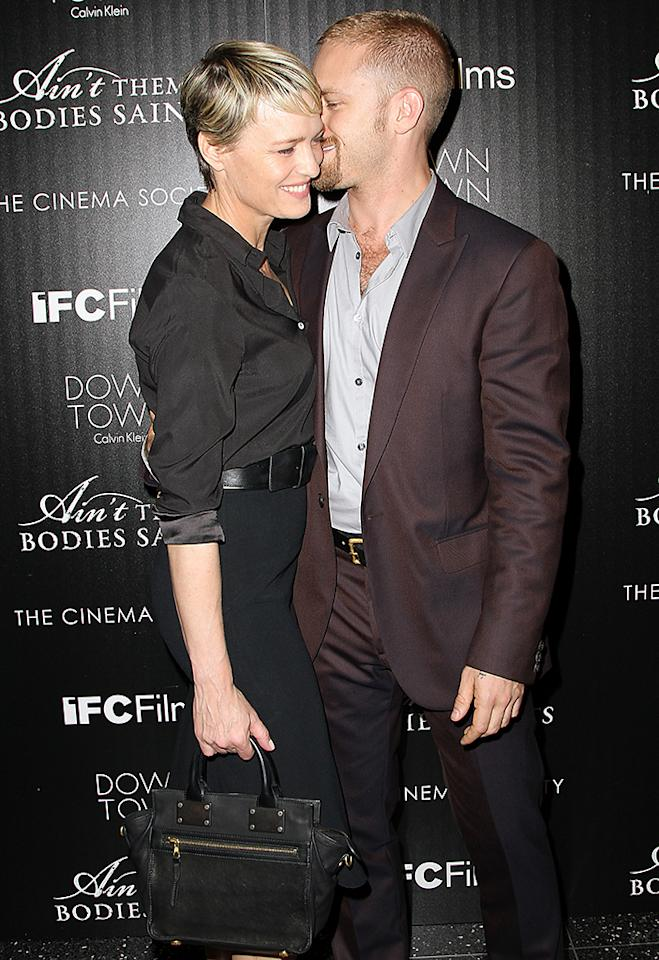 """NEW YORK, NY - AUGUST 13:  (L-R) Actress Robin Wright and actor Ben Foster attend the Downtown Calvin Klein with The Cinema Society screening of IFC Films' """"Ain't Them Bodies Saints"""" at The Museum of Modern Art on August 13, 2013 in New York City.  (Photo by Monica Schipper/FilmMagic)"""