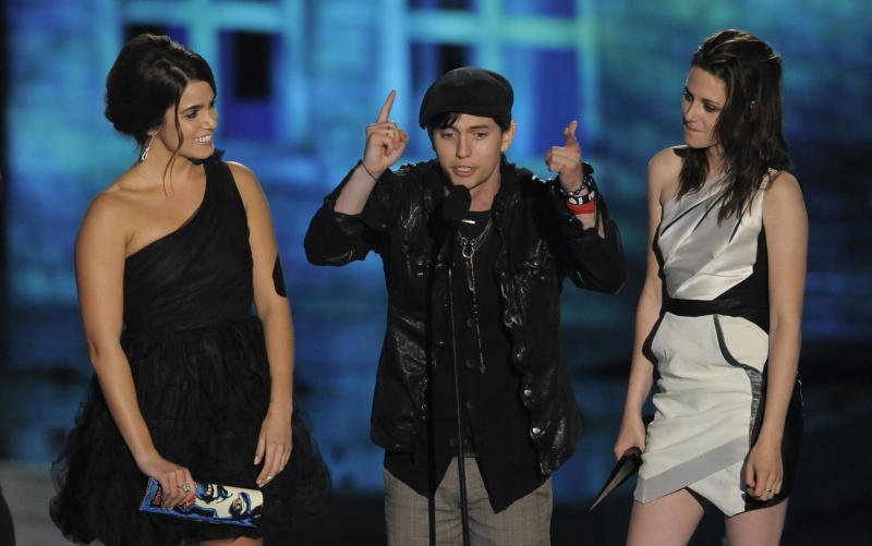 Nikki Reed, left,  Jackson Rathbone, center, and Kristen Stewart accept the award for best fantasy movie at the Scream Awards on Saturday Oct. 16, 2010, in Los Angeles. (AP Photo/Chris Pizzello)