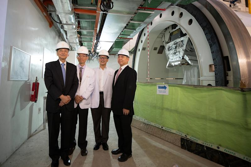 The team from Singapore Institute of Advanced Medicine Holdings standing beside the installed ProBeam Proton Therapy System at Biopolis: (from left) Dr Djeng Shih Kien (chairman and founder), Dr Sydney Yu (director of radiopharmaceutics), Dr Kwek Boon Han (chief medical officer) and Mr Lim Kah Chua (operations manager). PHOTO: Singapore Institute of Advanced Medicine Holdings