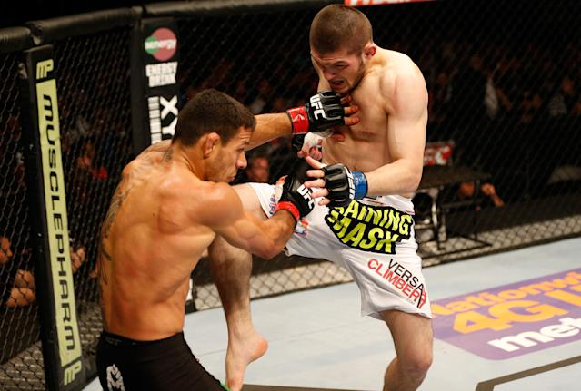 Khabib Nurmagomedov lands a flying knee against Rafael dos Anjos in their lightweight bout during the Fox UFC Saturday event at the Amway Center on April 19, 2014 in Orlando, Florida. (Getty Images)