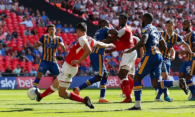 Richard Wood scores the extra-time winner for Rotherham against Shrewsbury.