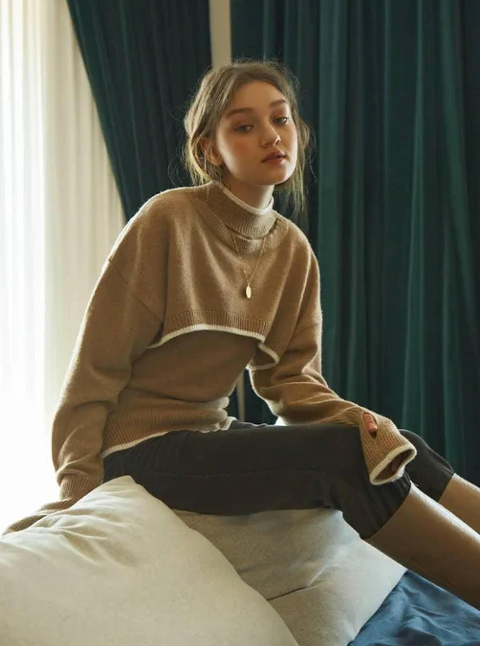 """This two-in-one piece comes with a sleeveless knit and cropped turtleneck that's perfect for rushed morning dressers who never have """"anything"""" to wear. Peep the readymade thumb holes that are way more convenient than making your own. $178, W Concept. <a href=""""https://us.wconcept.com/bolero-knit-set-710231307.html"""" rel=""""nofollow noopener"""" target=""""_blank"""" data-ylk=""""slk:Get it now!"""" class=""""link rapid-noclick-resp"""">Get it now!</a>"""