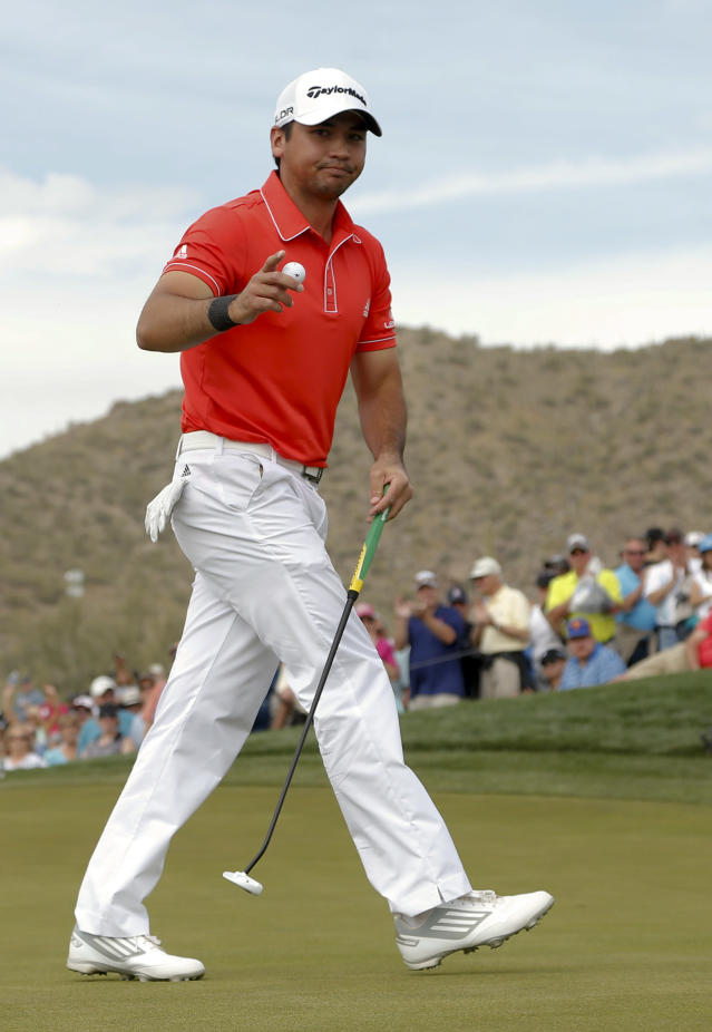 Jason Day, of Australia, waves on the eighth hole in his championship match against Victor Dubuisson, of France, during the Match Play Championship golf tournament on Sunday, Feb. 23, 2014, in Marana, Ariz. (AP Photo/Matt York)