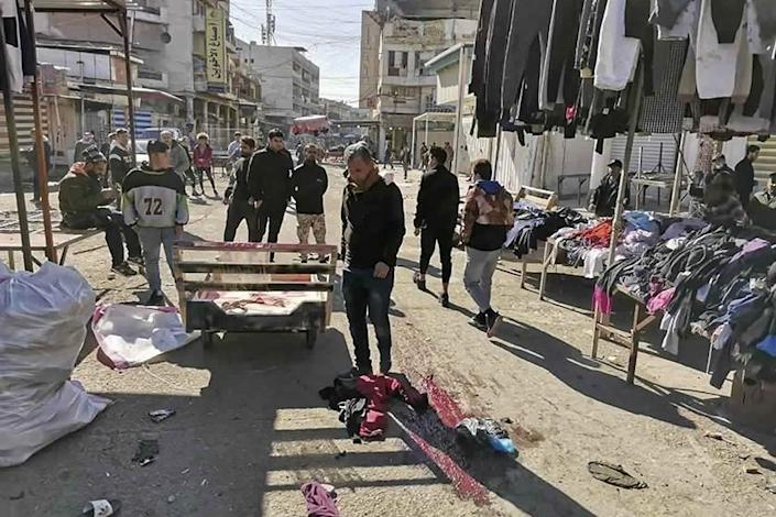 Residents gather at the site of twin suicide bombings in Baghdad on Jan. 21, 2021.