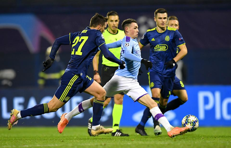 ZAGREB, CROATIA - DECEMBER 11: Phil Foden of Manchester City is challenged by Nikola Moro of GNK Dinamo Zagreb during the UEFA Champions League group C match between Dinamo Zagreb and Manchester City at Maksimir Stadium on December 11, 2019 in Zagreb, Croatia. (Photo by Dan Mullan/Getty Images)