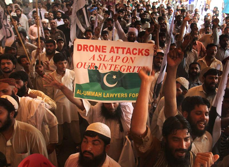 FILE --This July 5, 2013 file photo shows supporters Pakistan's religious party rally to condemn US drone attacks on militants' hideouts in Pakistani border area of Waziristan, in Lahore, Pakistan. The U.S. has drastically scaled back the number of drone attacks against militants in Pakistan and limited strikes to high-value targets in response to growing criticism. Those actions appear to have temporarily appeased Pakistan's powerful generals, but some U.S. are still worried about pushback from Pakistan's new civilian leaders, who took power in June with a strong stance on ending the attacks altogether. (AP Photo/K.M. Chaudary, File)