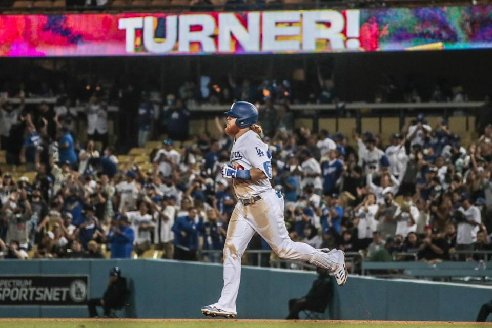 Justin Turner runs the bases after hitting a solo home run in the seventh inning against the Diamondbacks on Monday.