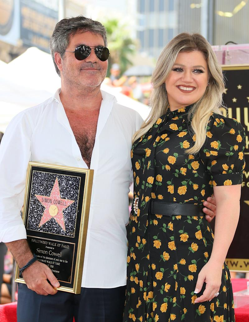 HOLLYWOOD, CA - AUGUST 22: Simon Cowell and Kelly Clarkson attend the ceremony honoring Simon Cowell with a Star on The Hollywood Walk of Fame held on August 22, 2018 in Hollywood, California. (Photo by JB Lacroix/WireImage)
