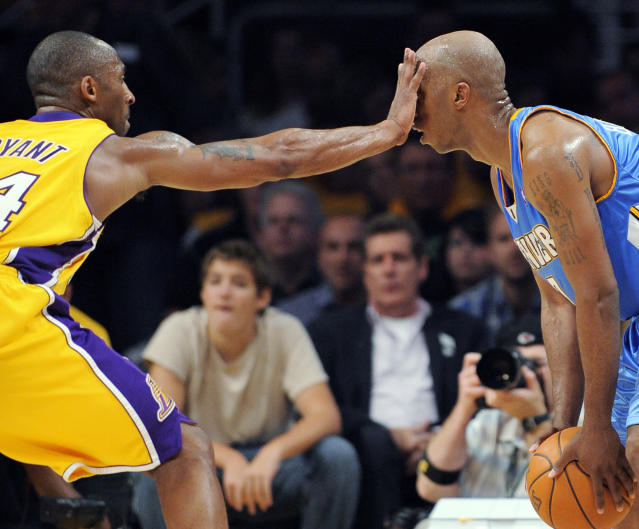 FILE - In this May 19, 2009, file photo, Los Angeles Lakers guard Kobe Bryant defends Denver Nuggets guard Chauncey Billups during the second half of Game 1 of the NBA basketball Western Conference finals, in Los Angeles. Bryant, the 18-time NBA All-Star who won five championships and became one of the greatest basketball players of his generation during a 20-year career with the Los Angeles Lakers, died in a helicopter crash Sunday, Jan. 26, 2020. (AP Photo/Mark J. Terrill, File)