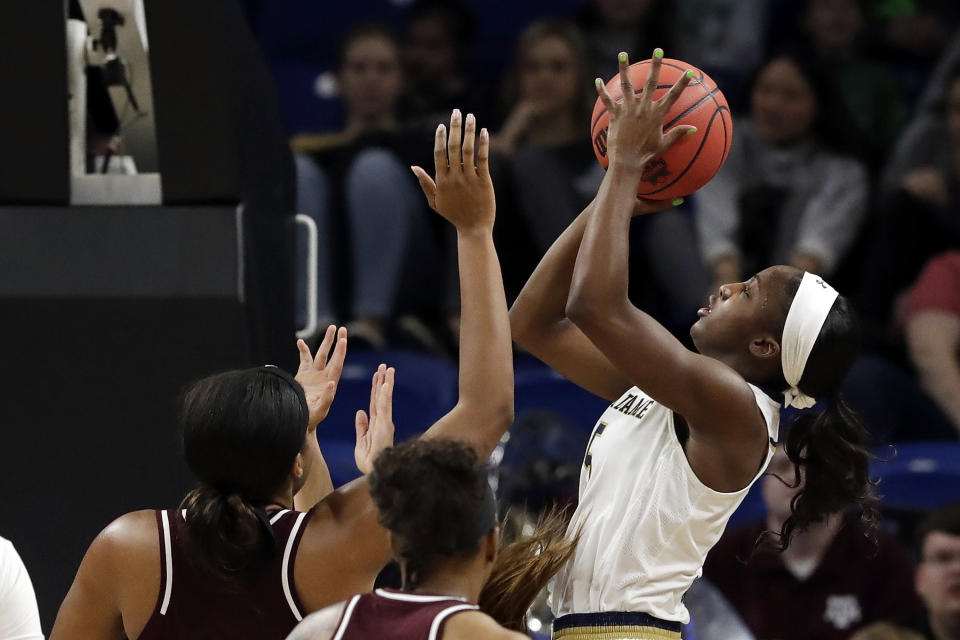 Notre Dame's Jackie Young, right, shoot over Texas A&M defense during the first half of a regional semifinal game in the NCAA women's college basketball tournament, Saturday, March 30, 2019, in Chicago. (AP Photo/Nam Y. Huh)