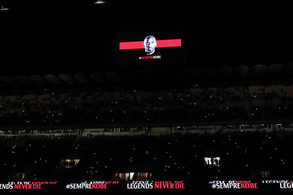 A picture of Kobe Bryant is projected on a giant screen during the Italian Cup soccer match between AC Milan and Torino, at the Milan San Siro Stadium, Italy, Tuesday, Jan. 24, 2020. Bryant, an 18-time NBA All-Star with the Los Angeles Lakers and a lifelong soccer fan, died Sunday with his 13-year-old daughter, Gianna, in a helicopter crash near Calabasas, California. He was 41. (AP Photo/Antonio Calanni)