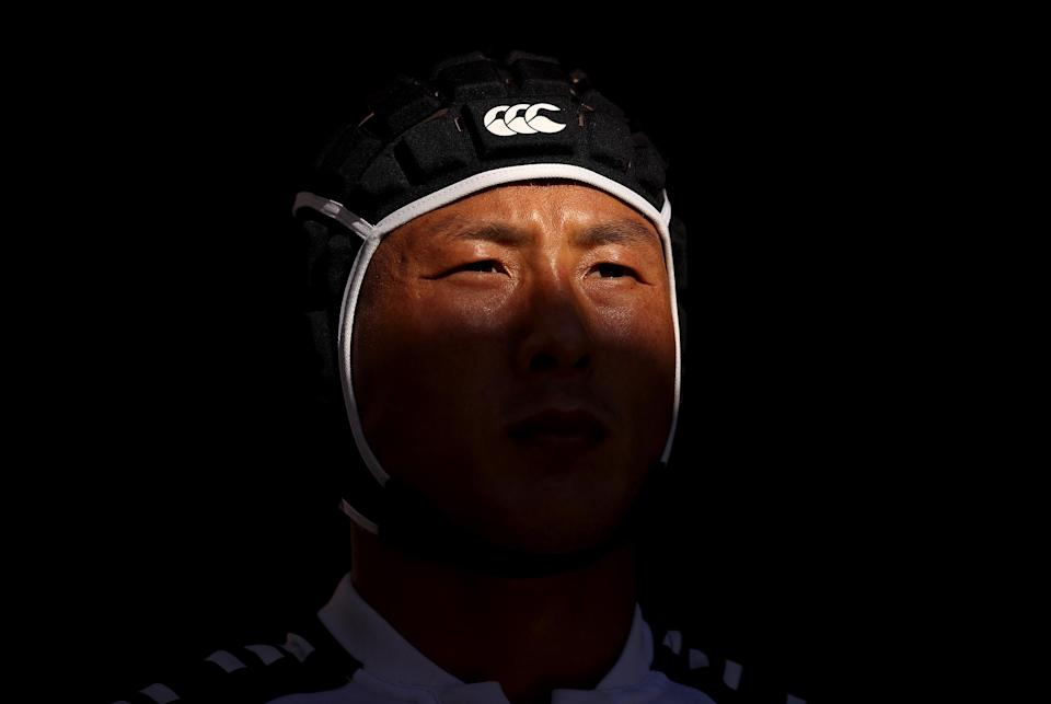 <p>Wanyong Park of South Korea waits to take to the field during the rugby sevens men's placing 9-12 match between Ireland and South Korea at Tokyo Stadium.</p>
