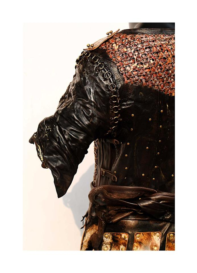 <p><span>The golden jewellery work on the armour is all hand finished in leather too.</span> </p>