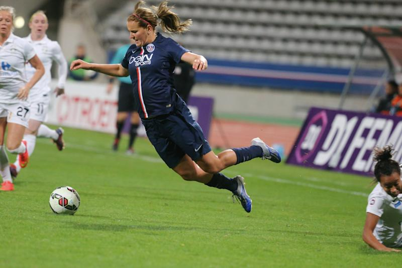 PARIS, FRANCE - OCTOBER 04: Lindsey Horan of Paris Saint-Germain in action during the Women Division 1 between Paris Saint-Germain FC and FCF Juvisy Essonne at Charlety on october 4, 2014 in Paris, France. (Photo by Xavier Laine/Bongarts/Getty Images)