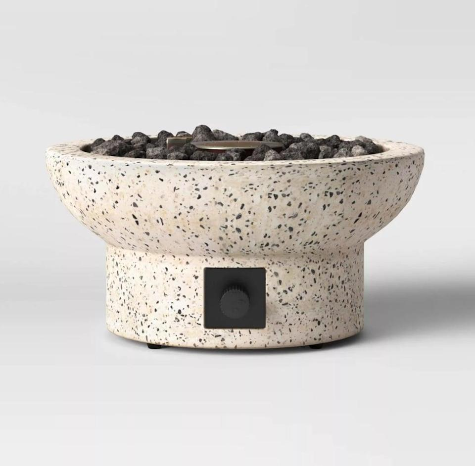 <p>The <span>Project 62 Terrazzo Propane Tabletop Fireplace</span> ($129) will make any space feel more cozy.</p>