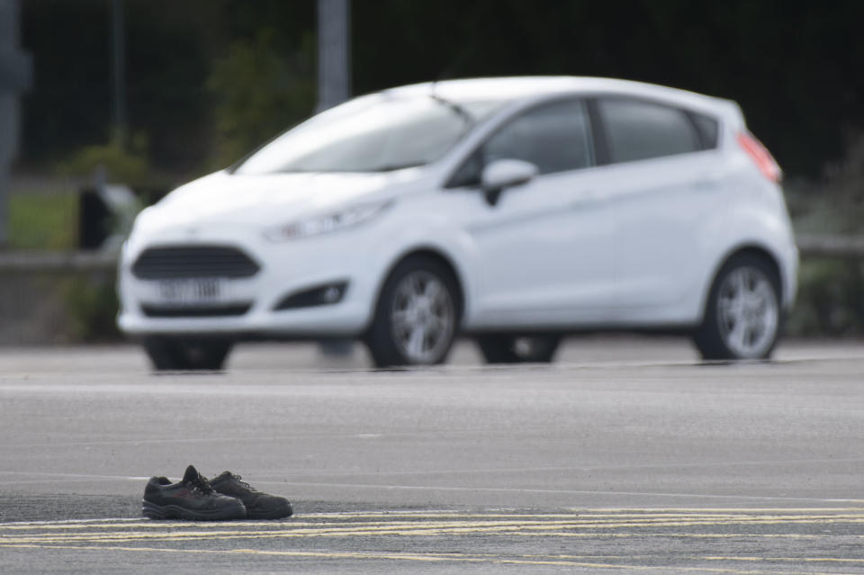 BRIDGEND, WALES - SEPTEMBER 25: A pair of boots left by a Ford worker in their car parking spaces following their final shift on September 25, 2020 in Bridgend, Wales. The Ford plant in Bridgend, which opened in May 1980, will shut down for the last time today, bringing to a close four decades of production at the site. The closure, announced in June 2019, will see the loss of hundreds of jobs. (Photo by Matthew Horwood/Getty Images)