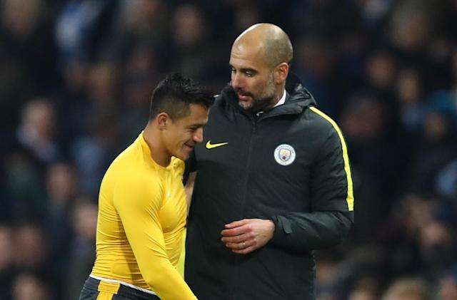 "<a class=""link rapid-noclick-resp"" href=""/soccer/players/alexis-sánchez"" data-ylk=""slk:Alexis Sanchez"">Alexis Sanchez</a> and Pep Guardiola embrace after the final whistle of a match between <a class=""link rapid-noclick-resp"" href=""/soccer/teams/manchester-city/"" data-ylk=""slk:Manchester City"">Manchester City</a> and <a class=""link rapid-noclick-resp"" href=""/soccer/teams/arsenal/"" data-ylk=""slk:Arsenal"">Arsenal</a> in 2016. (Getty Images)"
