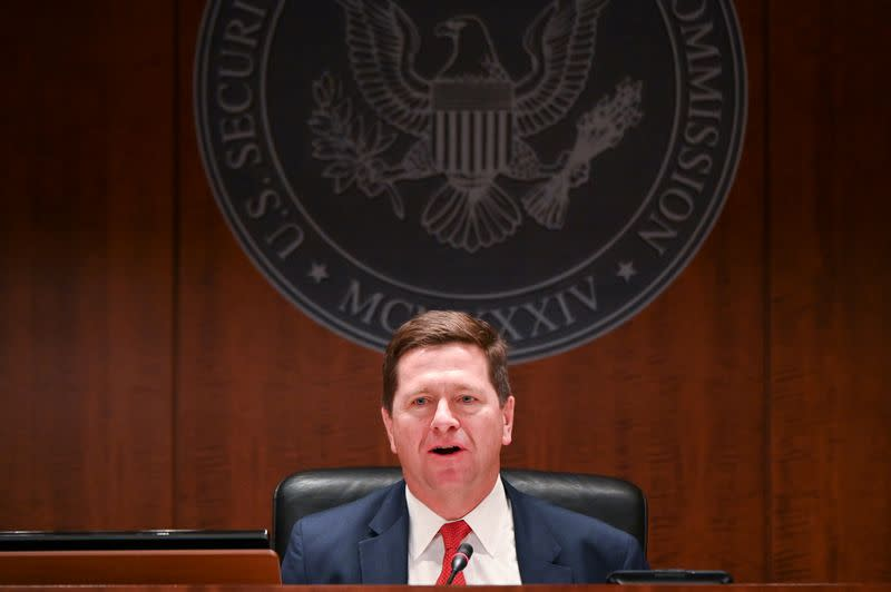 """FILE PHOTO: Chairman Clayton participates in a U.S Securities and Exchange Commission open meeting to propose changing its definition of an """"accredited investor"""" in Washington"""