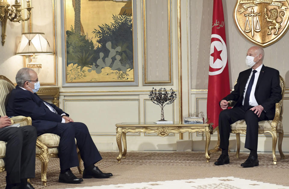 Algerian Foreign Minister Ramadhan Laamamra, left, meets Tunisian President Kais Saeid, to discuss the Tunisian crisis at the Presidential Palace in Carthage, outside Tunis, Tunisia, Tuesday, July 27, 2021. The leader of Tunisia's Islamist party and speaker of parliament said Tuesday that his party is working to form a national front. (AP Photo/Slim Abid)