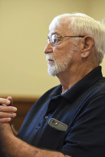 """Lowndes County supervisor Harry Sanders listens as Bishop Scott Volland, unseen, asks the county to consider removing a Confederate monument from the courthouse lawn during a Lowndes County Board of Supervisors meeting, Monday, June 15, 2020, in Columbus, Miss. After rejecting a proposal to move the monument, Sanders said this week that African Americans """"became dependent"""" during slavery and have had a harder time """"assimilating"""" into American life as other groups who have been mistreated have. His remark has prompted calls for his resignation. (Claire Hassler/The Commercial Dispatch, via AP)"""