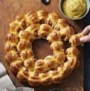 """<p>On Super Bowl Sunday, it's all about the presentation. These wreath-shaped piggies won't disappoint. </p><p><em><a href=""""https://www.goodhousekeeping.com/food-recipes/a11579/easy-pigs-in-a-blanket-recipe-122799/"""" rel=""""nofollow noopener"""" target=""""_blank"""" data-ylk=""""slk:Get the recipe for Pigs in Blanket Wreath »"""" class=""""link rapid-noclick-resp"""">Get the recipe for Pigs in Blanket Wreath »</a></em></p><p><strong>RELATED:</strong> <a href=""""https://www.goodhousekeeping.com/food-recipes/g1305/super-bowl-recipe-ideas/"""" rel=""""nofollow noopener"""" target=""""_blank"""" data-ylk=""""slk:60 Ultimate Super Bowl Recipes That Will Satisfy a Hungry Crowd"""" class=""""link rapid-noclick-resp"""">60 Ultimate Super Bowl Recipes That Will Satisfy a Hungry Crowd</a></p>"""