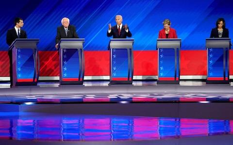 Five candidates for the Democratic presidential bid line up during a debate in Houston - Credit: REUTERS/Mike Blake