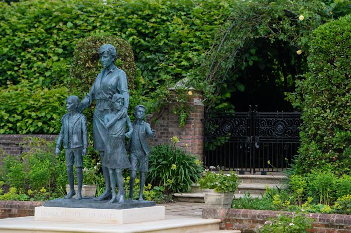 LONDON, ENGLAND - JULY 01: The statue of Diana, Princess of Wales, by artist Ian Rank-Broadley, in the Sunken Garden at Kensington Palace. The bronze statue depicts the princess surrounded by three children to represent the
