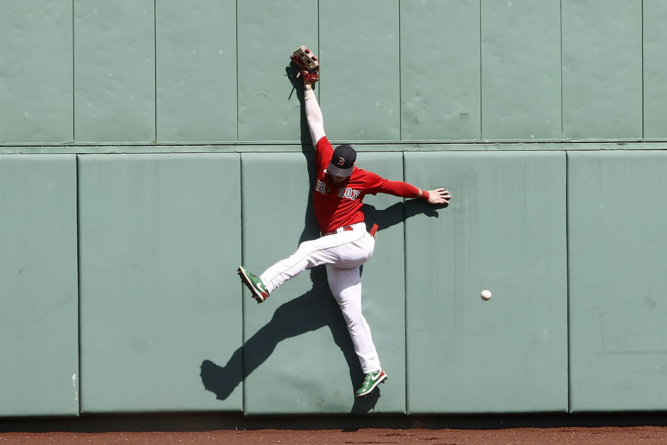 Boston Red Sox's Alex Verdugo cannot get to a triple by Tampa Bay Rays' Wander Franco during the first inning of a baseball game Monday, Sept. 6, 2021, at Fenway Park in Boston. (AP Photo/Winslow Townson)