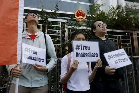Members of student group Scholarism hold up placards during a protest about the disappearances of booksellers outside China's liaison office in Hong Kong, China January 6, 2016. REUTERS/Bobby Yip