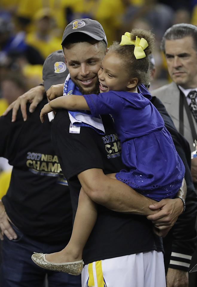 <p>Golden State Warriors guard Stephen Curry hugs his daughter Riley after Game 5 of basketball's NBA Finals between the Warriors and the Cleveland Cavaliers in Oakland, Calif., Monday, June 12, 2017. The Warriors won 129-120 to win the NBA championship. (AP Photo/Marcio Jose Sanchez) </p>