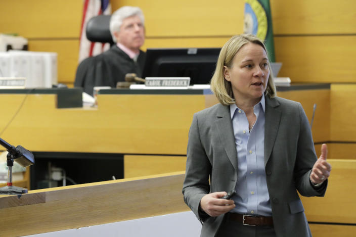 Assistant Washington state Attorney General Lori Nicolavo, right, makes her opening arguments, Tuesday, Feb. 18, 2020, in Pierce County Superior Court in Tacoma, Wash., on the first day of a civil lawsuit over the murder of Charlie and Braden Powell, who were attacked and killed by their father Josh Powell in 2012 while he was under suspicion for the disappearance of his wife, Susan Powell in Utah. The boys' grandparents allege that negligence by the Washington state Department of Social and Health Services was a contributing factor that led to the deaths of their grandsons. (AP Photo/Ted S. Warren)