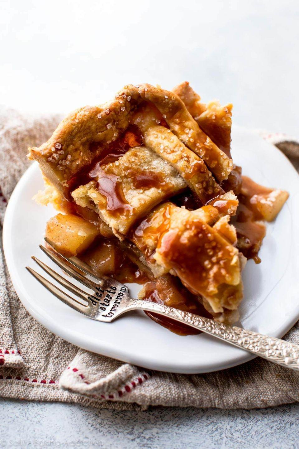 """<p>A homemade caramel sauce makes this treat sinfully sweet, but the cinnamon balances it out with some spice.</p><p><strong>Get the recipe at <a href=""""https://sallysbakingaddiction.com/caramel-pear-pie/"""" rel=""""nofollow noopener"""" target=""""_blank"""" data-ylk=""""slk:Sally's Baking Addiction"""" class=""""link rapid-noclick-resp"""">Sally's Baking Addiction</a>.</strong> </p>"""