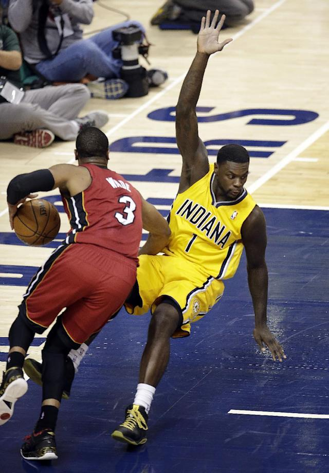 Miami Heat guard Dwyane Wade (3) commits an offensive foul on Indiana Pacers guard Lance Stephenson (1) during the second half of Game 1 of the Eastern Conference finals NBA basketball playoff series, Sunday, May 18, 2014, in Indianapolis. (AP Photo/AJ Mast)
